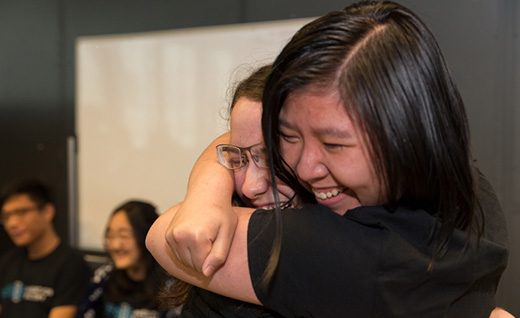 Keti Vaso and Sara Huang embrace after winning. Photos by Joao Enxuto / The Cooper Union