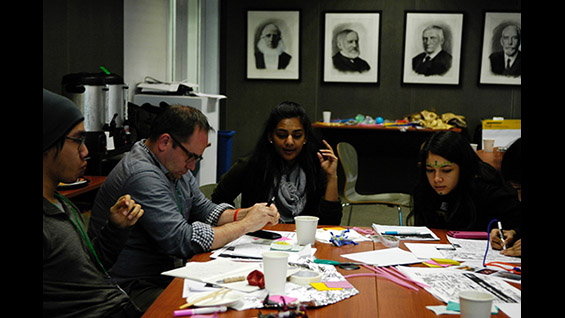 Professor Oliver Medvedik and students worked on one of the design thinking teams during the 2-day workshop