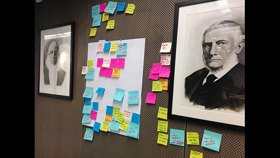 Using Post-It notes to brainstorm ideas in the Menschel Board Room