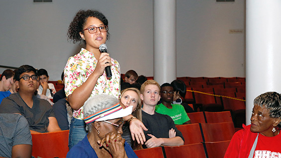 Roberta Nin Feliz asks a question of the Tuskegee Airmen in The Great Hall on August 7, 2014