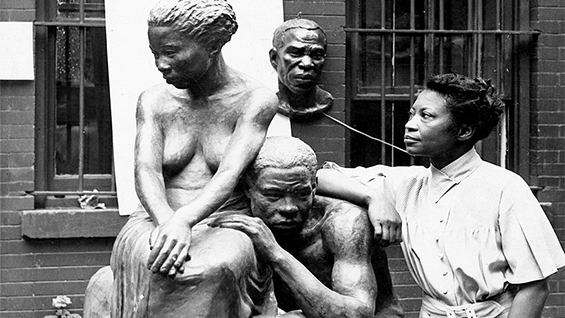 Augusta Savage posing with her sculpture Realization, created as part of the Works Progress Administration's Federal Art Project. ca. 1938. Photo by Andrew Herman