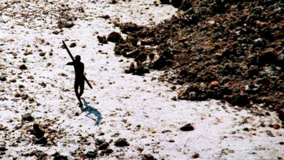 A member of the Sentinelese tribe firing an arrow at a helicopter © Indian Coastguard