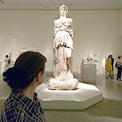 Mary Stieber views the cult statue of Athena from Pergamum at the Metropolitan Museum of Art. Photo by Katherine Leu