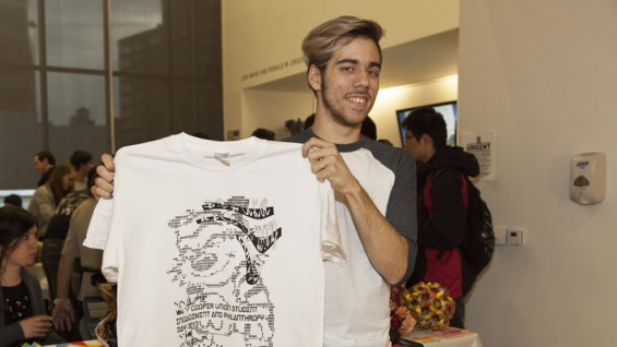 Hunter Mayton (A'2016) holds up an alumnus-designed t-shirt giveaway for student donors