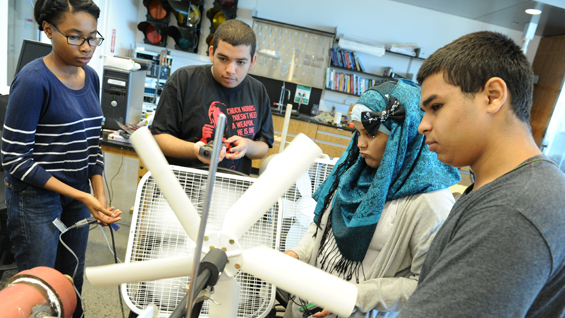 Sustainable and green energy students test prototypes to gather energy from wind.