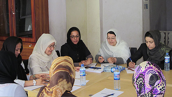 Ms. Mojadidi (in black with glasses) at the Women's Assembly Hall needs assessment meeting in Faryab province.