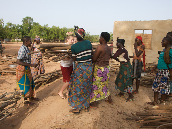Madeline Foster (CE), Lili Ehrlich (ME) working with wood carriers at the Jirapa wood market, UWR Ghana. Funded by NSF
