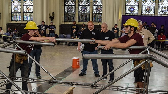 Teams lose points for employing too many builders, so Cooper used a 3-person team including Miles Barber CE'18 (lt) and Andrew Peña CE'18 (rt).
