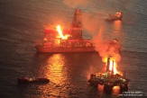 Gasses captured from the leaking Macondo well are flared by Transocean drill ship Discoverer Enterprise and rig Q4000.