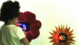 P.S.347 student observing sound-to-light flower LEDs with color filter