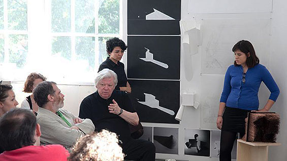 Lebbeus Woods (gesturing) at the Architectonics, Spring 2010 review